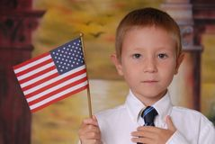 Flag Boy 5. Young boy in tie holding American flag Stock Photos