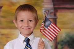 Flag Boy 7. Young boy in tie holding American flag Stock Image
