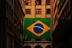 Flag of Brazil in front of building. royalty free stock photography