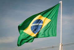 Flag of Brazil hoisted. Brazilian flag waving with the wind Stock Photo
