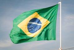 Flag of Brazil hoisted. Brazilian flag waving with the wind Stock Photos
