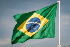 Flag of Brazil hoisted. Brazilian flag waving with the wind Stock Photography