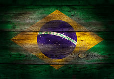 Flag of Brazil painted on grungy wood plank background Royalty Free Stock Photo