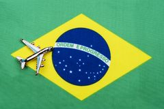 Flag of Brazil and the plane. The concept of travel. Toy airplane on the flag of Brazil Royalty Free Stock Photo