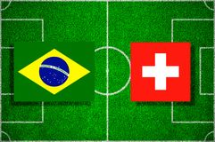 Flag Brazil - Switzerland on the football field. Football match.  Stock Image