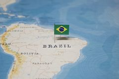 The Flag of brazil in the world map.  stock photo