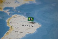 The Flag of brazil in the world map.  stock image