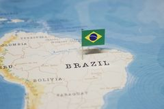 The Flag of brazil in the world map.  stock images