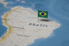 The Flag of brazil in the world map.  stock photos