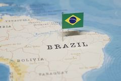 The Flag of brazil in the world map.  royalty free stock photography