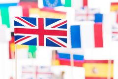 Flag of Britain against EU member-states flags. Picture of small paper flag of Great Britain against flags of European Union member-states Royalty Free Stock Photography