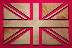 flag of Britain, stripes and triangles carved from wood royalty free stock image