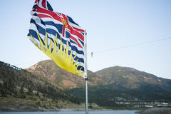 Flag British Columbia. Provincial flag of British Columbia in the wind on ferry Stock Image