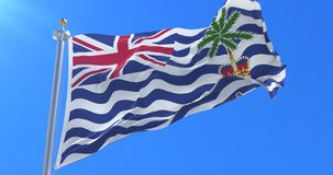 Flag of British Indian or Indian Britons waving at wind in slow with blue sky, loop. Ed stock video