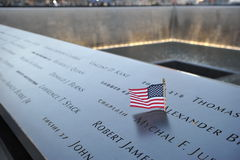 Flag on Bronze at the September 11 Memorial. A flag was placed on the bronze panels surrounding the memorial pools at the World Trade Center site in New York Stock Images