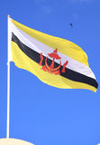 Flag of Brunei Darussalam. The flag of Brunei Darussalam, waving with pride and dignity, in bright day and blue sky Stock Photography