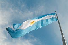 Flag Buenos Aires growing against the blue sky. Stock Images