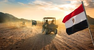 Flag and buggies in desert Stock Photography