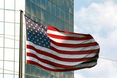Flag & Building 1. American flag flying beside a tall building with mirrored windows Royalty Free Stock Image