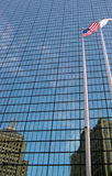 Flag and Building. Reflection of the american flag in glass office building Royalty Free Stock Photos