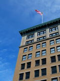 Flag on building. American flag on tall building Royalty Free Stock Photo