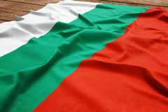 Flag of Bulgaria on a wooden desk background. Silk Bulgarian flag top view.  royalty free stock photos