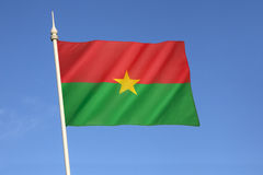 Flag of Burkina Faso. Adopted on 4th August 1984. The flag uses the Pan-African colors, reflecting both a break with its colonial past and its unity with stock photo
