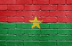 Flag of Burkina Faso on brick wall. Flag of Burkina Faso painted onto a grunge brick wall stock photo
