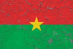 Flag of Burkina Faso painted on cracked dirty wall. National pattern on vintage style surface.  stock photos