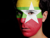 Flag of Burma. Painted on a Face of a Young Man stock photos