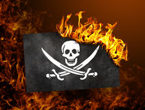 Flag burning - Pirate Royalty Free Stock Photography