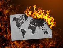 Flag burning - world map Stock Photo