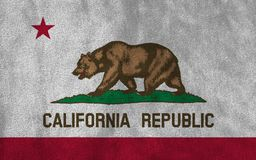 Flag of California State United States of America. On fabric background close up stock image