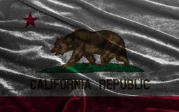 Flag of California State United States of America. On velvet fabric background close up stock images