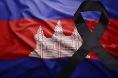 Flag of cambodia with black mourning ribbon. Waving national flag of cambodia with black mourning ribbon Stock Photos