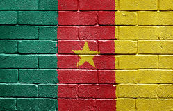 Flag of Cameroon on brick wall. Flag of Cameroon painted onto a grunge brick wall royalty free stock photo