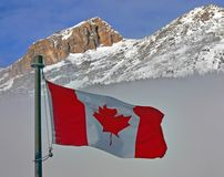 Flag of Canada. A Canada flag with a rocky mountain and mist background Royalty Free Stock Photos