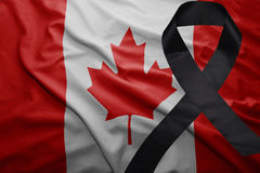 Flag of canada with black mourning ribbon. Waving national flag of canada with black mourning ribbon Stock Photography