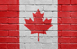 Flag of Canada on brick wall. Flag of Canada painted onto a grunge brick wall Stock Photography