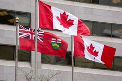 Flag of Canada and Flag of Ontario Waving Together Royalty Free Stock Photography