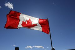 Flag of Canada on the mast stock image