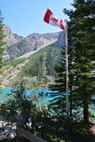 Moraine lake. The flag of canada, Moraine lake royalty free stock image