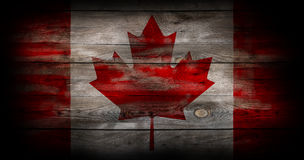 Flag of Canada painted on grungy wood plank Stock Photos