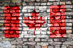 Flag of Canada painted on an old brick wall Stock Photo