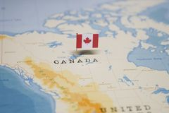 The Flag of canada in the world map stock photo