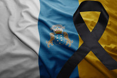 Flag of canary islands with black mourning ribbon. Waving national flag of canary islands with black mourning ribbon Stock Photography