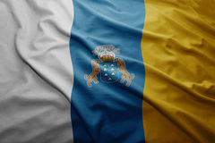 Flag of Canary Islands. Waving colorful national Canary Islands flag Stock Images