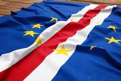 Flag of Cape Verde on a wooden desk background. Silk Cape Verdian flag top view.  stock photos