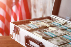 Flag and case with money. Stock Images