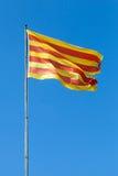 Flag of Catalonia above blue sky Royalty Free Stock Photos